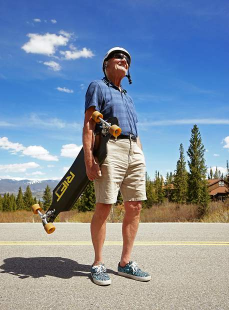Longtime Summit County local Jim Bowden between longboard runs on a sunny June day in his Wildernest neighborhood. At 74 years old, Bowden still gets out once or twice per week for longboard runs on his favorite routes high above Dillon Reservoir and the towns below.