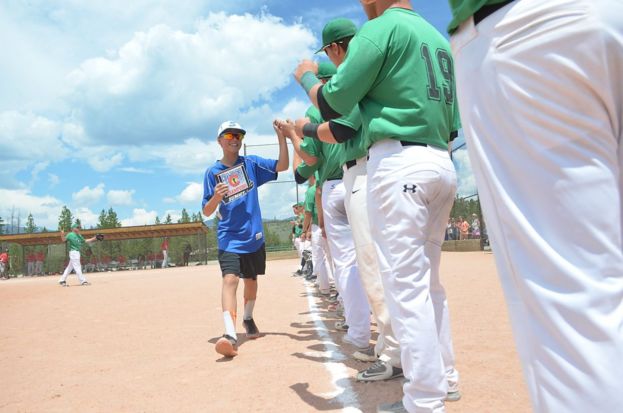 A Summit Extreme Black Diamonds U12 player gets high-fives from junior-level players after the U12 team won the 2015 CABA State Championship in 2015.