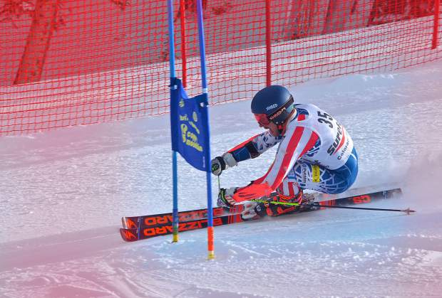 A skier, photographed through the safety fence, gets low to round a gate in the lower section of the giant slalom course at Copper Mountain during the 2016 Surefoot FIS Colorado Ski Cup on Nov. 30. The annual event drew nearly 400 male and female ski racers from 23 nations for four days of GS and super-G racing.