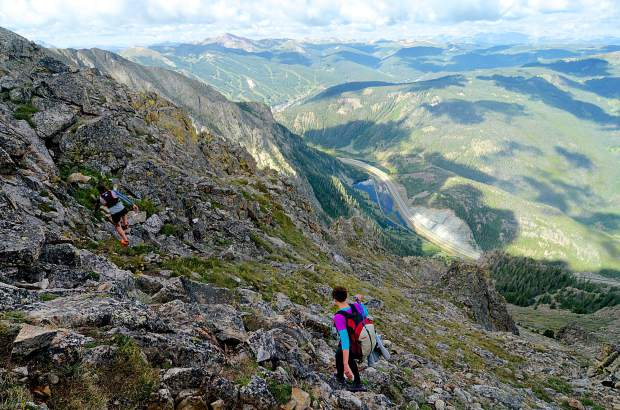 Local hikers Sara Skinner (purple) and Ben Trollinger find a route through boulders and high-alpine tundra on the Copper Mountain side of the Tenmile Range.