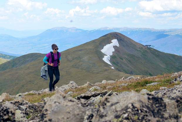Frisco local Sara Skinner reaches the summit of Peak Nine (13,195 feet) during an attempt of the Tenmile Traverse in August. The upper terminal of Imperial Chair on Peak Eight is in the background.