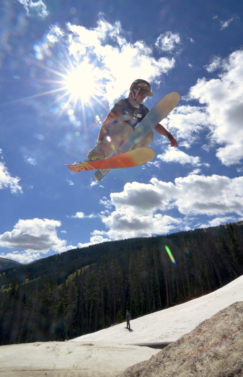 A skier spins off the second jump in the three-pack jump line at Woodward Copper's summer snow park.
