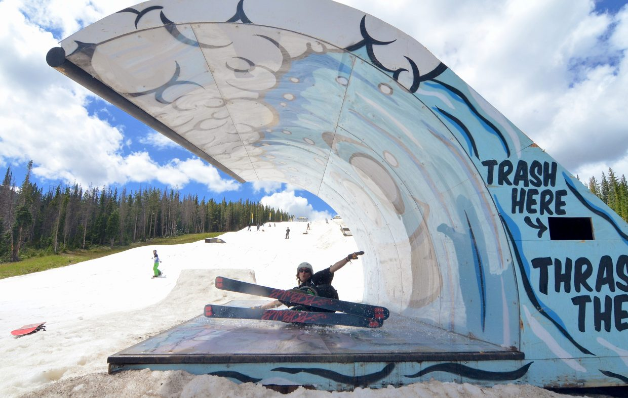 A Woodward Copper ski coach lays it out on the wave feature at the summer snow park on Copper Mountain in July.
