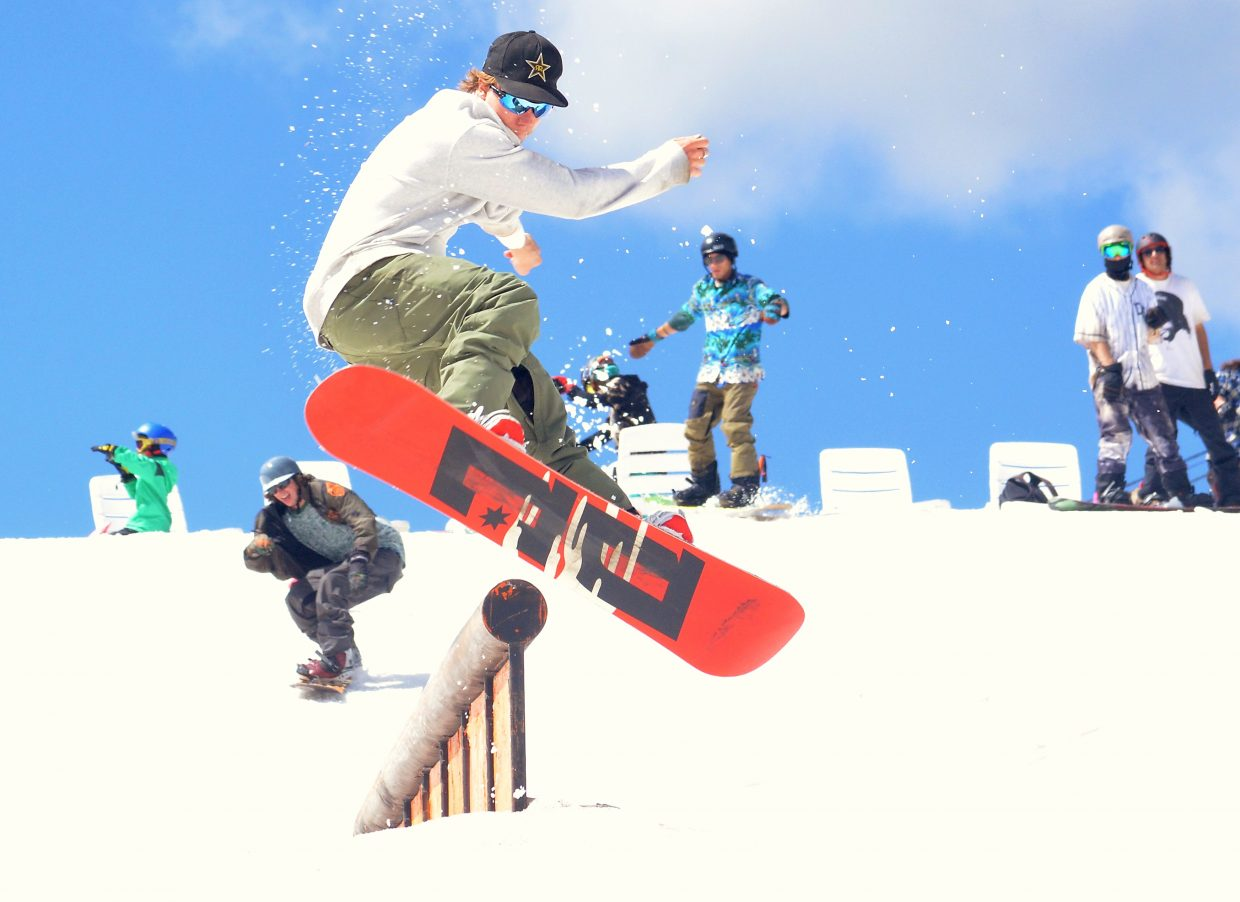 Pro snowboarder Torstein Horgmo spins a switch 450 off the down tube at the Woodward Copper summer snow park in July. Horgmo was one of several visiting pros at the park, which hosts adult and youth campers from June to August.