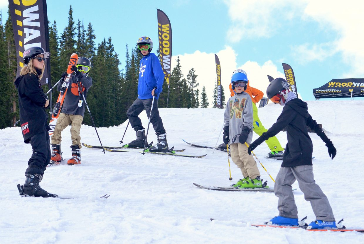 A group of young Woodward Copper campers gets ready to practice rails in the jib line at the summer snow park in July.