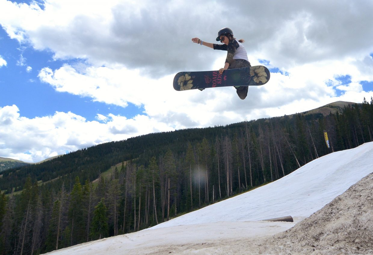 Summit County local Jenise Spiteri tweaks a method over the second jump in the three-pack jump line at the Woodward Copper summer snow park in July.