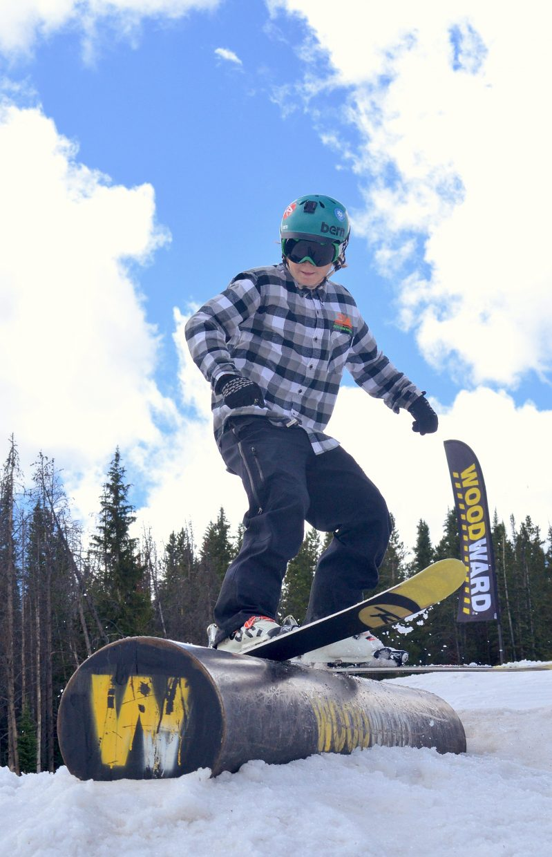 A young camper slides one of a dozen jib features at the Woodward Copper summer snow park in July.