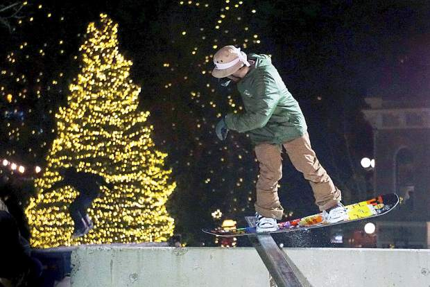 A snowboarder nose presses a rail on the Dew Tour streetstyle course on Washington Avenue in Breckenridge in 2015. The event returns with ski and snowboard on Dec. 9 from 6-8 p.m.