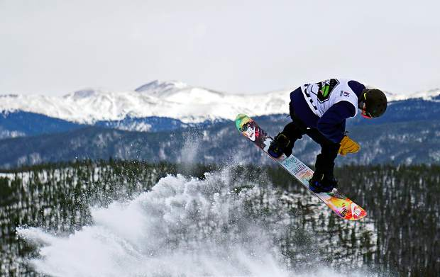A snowboarder takes off from a jump during the Dew Tour men's slopestyle semi-finals at Breckenridge Ski Resort in 2015. The event returns to Breckenridge with a new format Oct. 8-11, including a two-part ski and snowboard slopestyle for men and women on Dec. 9-10.