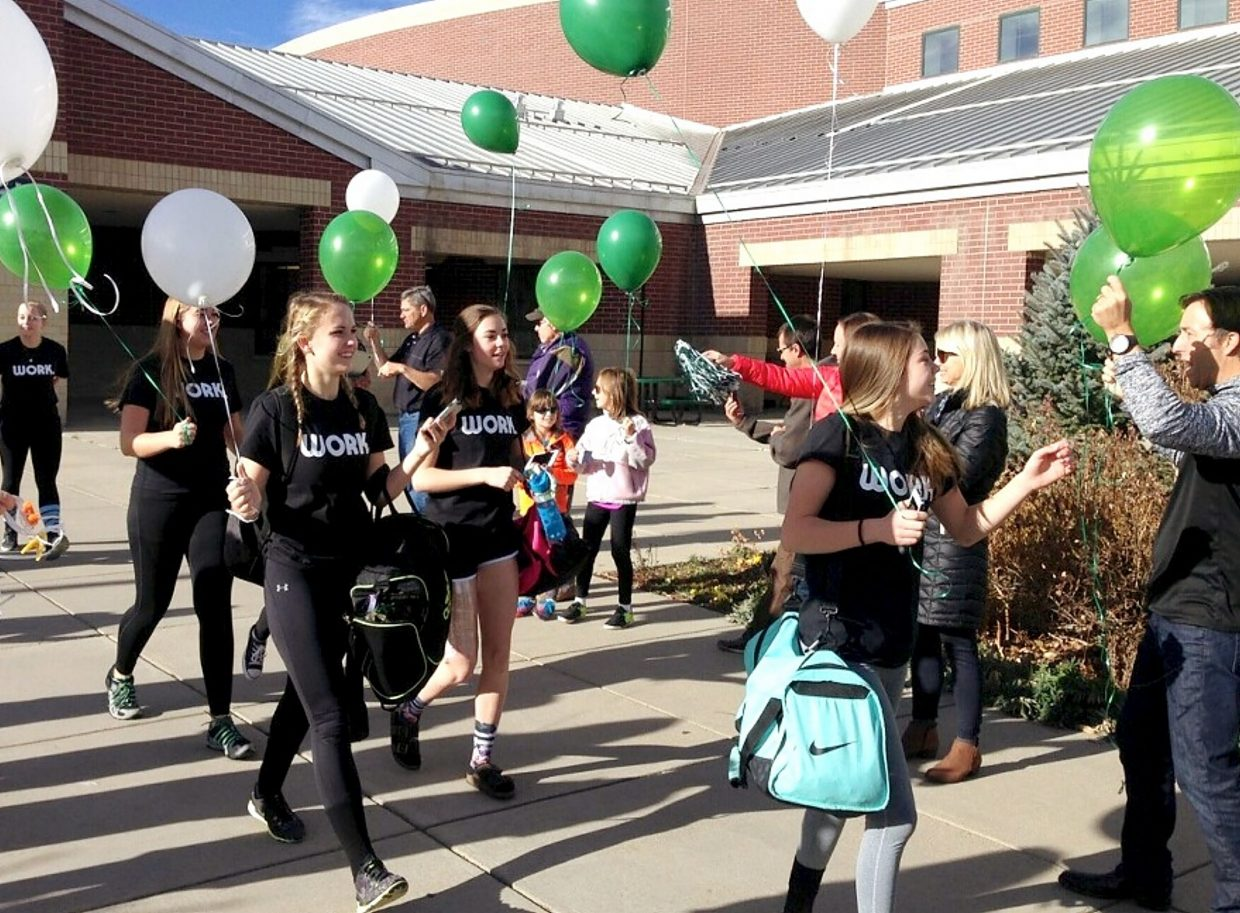 Parents and fans bid farewell to the Summit varsity volleyball team before the first round of the 4A Regional State Tournament on Nov. 4 in Longmont. Summit lost both matches: one to Silver Creek, one to Palmer Ridge.