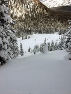 A man caught in this snow slide while backcountry skiing on Red Table Mountain escaped with a broken leg. The slide was about 50 feet wide and swept him along with about 500. The two people he was skiing with had not yet started down the slope.