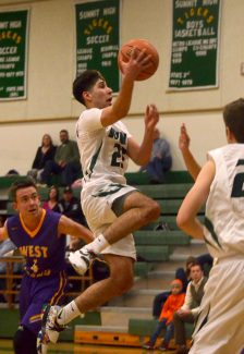 Summit junior Dimitri Preciado (23) jumps past West Grand defenders for a layup during a home varsity basketball game on Jan. 12. The Tigers won, 78-58.