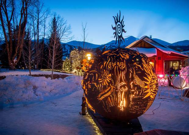 The Biodiversity Fire Sphere by Shane Shane illuminated on Friday night in Breckenridge.