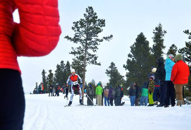 A middle school athlete with the Aspen Valley Ski and Snowboard Club passes by parents and other cheering spectators in the final stretch of the Gold Run Nordic races in Frisco on Jan. 9, 2016. The Frisco Cup Nordic race series debuts on Jan. 4 as a warm-up for the 2017 Gold Run races on Feb. 12.