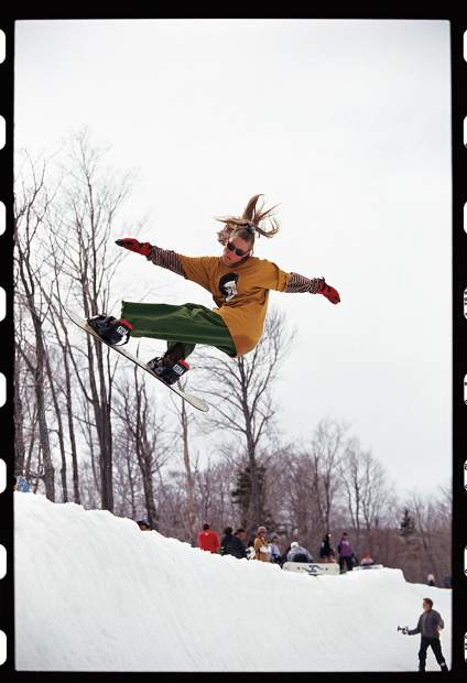 Janna Meyen (shot by Jon Foster), one of the first female pro snowboarders, in 1993. The photo highlights Meyen's hand-made high backs, which she cut short to fit her style of riding.