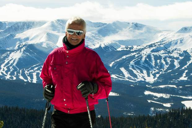 Former Norwegian downhill champion Trygve Berge on top of Keystone Resort with his home mountain, Breckenridge, in the background. Berge teamed with Sigurd Rockne to open Breck in the '60s.