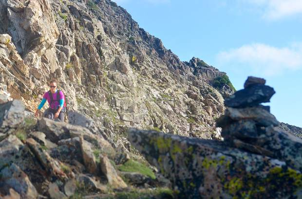 Frisco local Sara Skinner aims for a cairn marking the faint trail between Peak Three (12,676 feet) and Peak Four (12,866) during an attempt of the Tenmile Traverse in August.