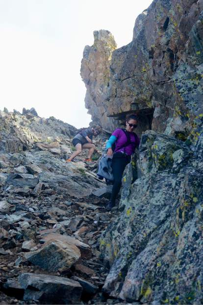 Local hikers Sara Skinner (purple) and Ben Trollinger weave through boulders and loose scree between Peak Three (12,676 feet) and Peak Four (12,866 feet) during an attempt of the Tenmile Traverse in August.