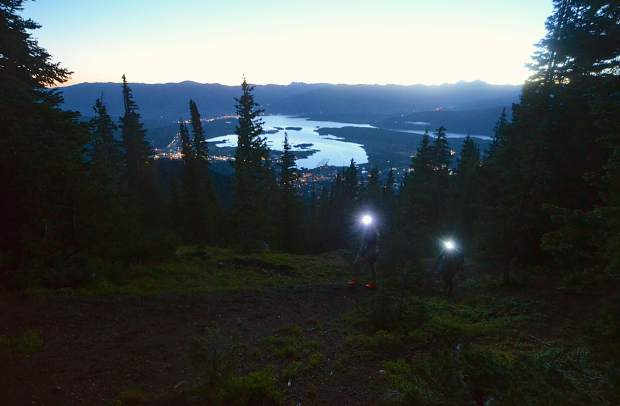 The sun begins to rise and reflect off Lake Dillon early on the approach to Peak One (12,805 feet) during the Tenmile Traverse.