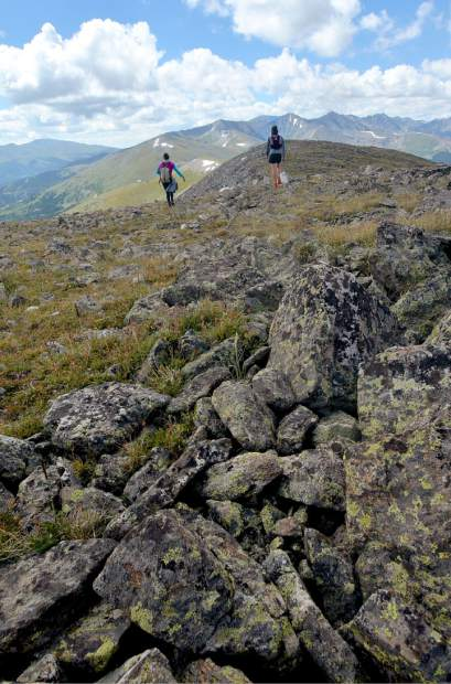 Local hikers Sara Skinner (purple) and Ben Trollinger make quick work of high-alpine routefinding between Peak Four (12,866 feet) and Peak Five (12,855 feet) during an attempt of the Tenmile Traverse.