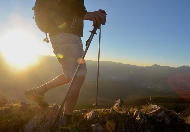 A hiker moves along the ridgeline just below the summit of Peak One (12,805 feet) at sunrise. Peak One is the first major climb of the Tenmile Traverse, a 14.5-mile trek on high-alpine terrain between Frisco and Breckenridge.
