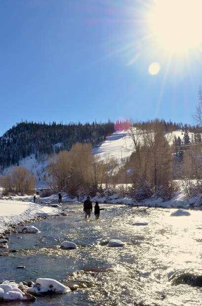 A smattering of anglers cast on the Blue River below the Dillon Dam in Silverthorne on a chilly December morning. The stretch is filled with trout and popular for winter fly-fishing.
