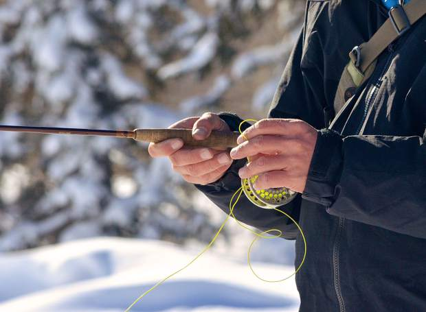 Breckenridge Outfitters guide Chip Swanson demonstrates casting technique for an introductory group near the Blue River in Silverthorne in December. Come winter, fish are conserving energy, Swanson said, and that demands confident technique from anglers.
