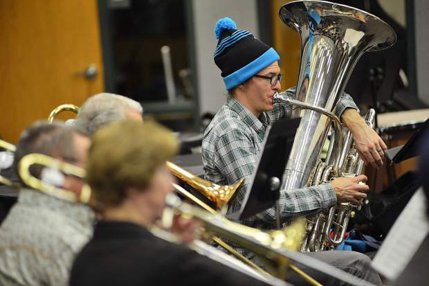 Summit Middle School band teacher Mark Koob works the tuba during a Thursday night practice of the Summit Concert Band at Summit High School.