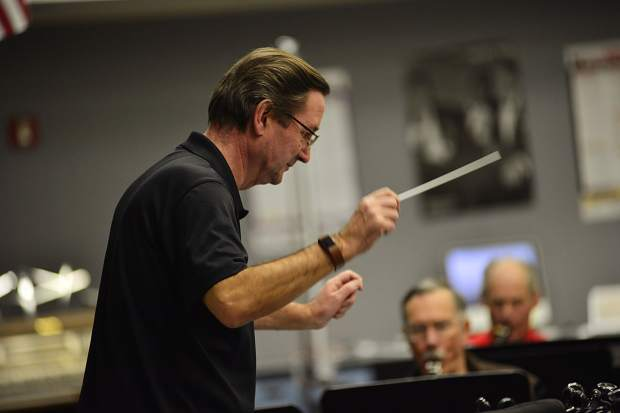 Guest conductor Graham Jones leads the Summit Concert Band on Thursday at Summit High School during a rehearsal for a Feb. 19 performance in Dillon.