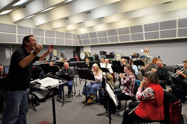 Guest conductor Graham Jones leads the Summit Concert Band during a rehearsal Thursday night at Summit High School. The band will perform Feb. 19 in Dillon.