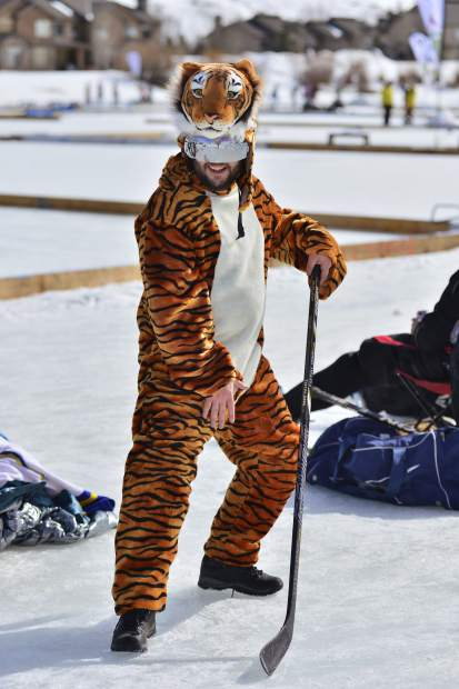 What's a hockey tournament without a man in a tiger suit? Ari Sachter-Smith, of Denver, made sure nobody would ask that question Friday at the Pabst Colorado Pond Hockey Tournament in Silverthorne.