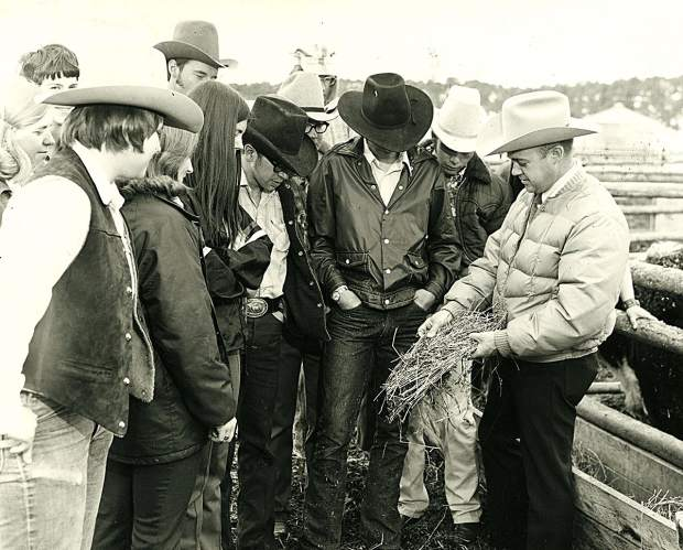 In Colorado Mountain College';s early days, the West Campus (now known as CMC Spring Valley) had a farm ranch management program. Shown here at right in the light-colored coat is Bill Wright, program manager.