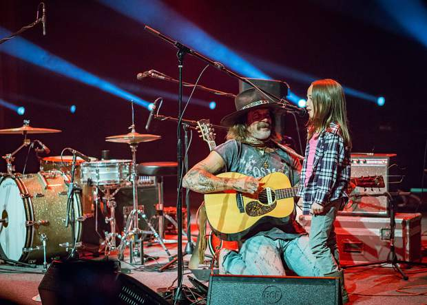 Donavon Frankenreiter interacts with a young girl on stage as he performs March 10 at the Riverwalk Center in Breckenridge.