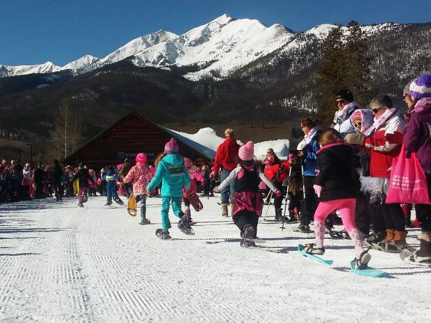 Lil' Stompers round the bend during the kids race at the Frisco Nordic Center.