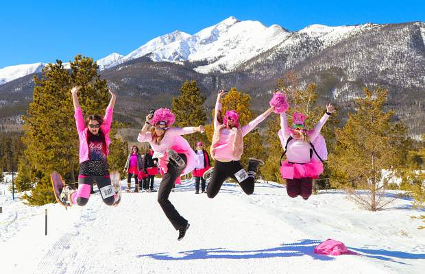 Some of the more than 900 participants in Snowshoe for the Cure jump for joy as they near the finish line Saturday at the Frisco Nordic Center. The event raised more than $90,000 in the fight against breast cancer.