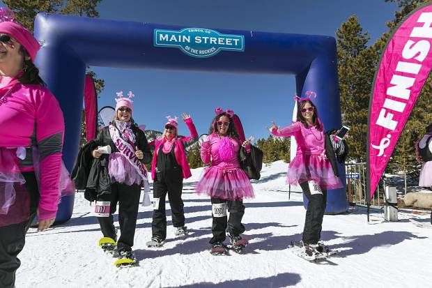 A group of pink snowshoers crosses the finish line ath the 15th annual Snowshoe for the Cure in Frisco on March 4. To date, this snowshoe fun-run through the woods at the intersection of