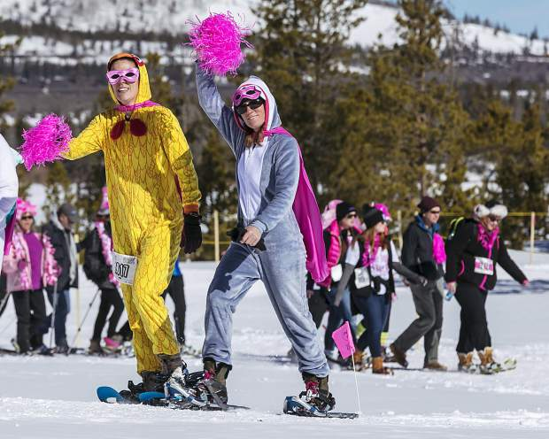 Costumed snowshoers leave the start line at the annual Snowshoe for the Cure fundraiser in Frisco on March 4. To date, this snowshoe fun-run through the woods at the intersection of