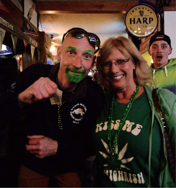 With his goatee and eyebrows dyed green, George Altz celebrates St. Patrick's Day with M.B. Greene on Friday at Murphy's Irish Pub in Silverthorne.