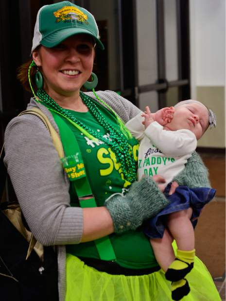 Randi Paquette of Silverthorne holds her daughter Addison as they pose for a photo on Addison's first St. Patrick's Day on Friday in Dillon.