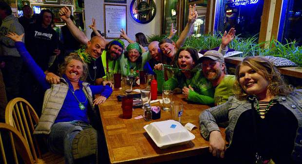 Clockwise from bottom left, Mary and Mark Miola, Earl and Wendy Clairmont, Jason and Meredith Adams, Heather Wickstrom, Benjamin Becker and Ashley Batty show their green Friday night for St. Patrick's Day at Murphy's Irish Bar in Silverthorne.