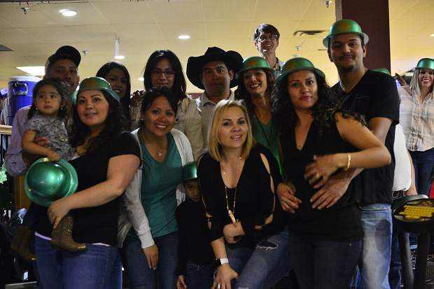 A group celebrating Yanitza Rivera's birthday makes time for a St. Patrick's Day photo Friday night at Lakeside Bowl in Dillon. Rivera is third from right, next to the man in the cowboy hat.