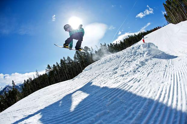 A grom grabs method over one of several small kickers in the Incubator beginner park at Keystone.