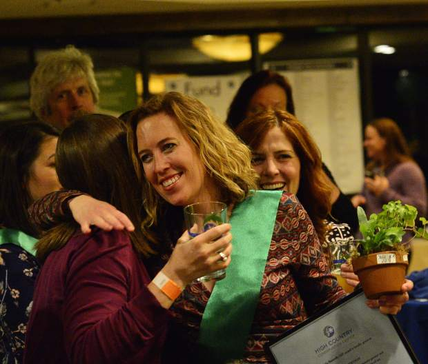 Nora Gilbertson gets a big hug after being announced as a Green Scene award winner Friday night at the 28th Tim McClure Benefit.