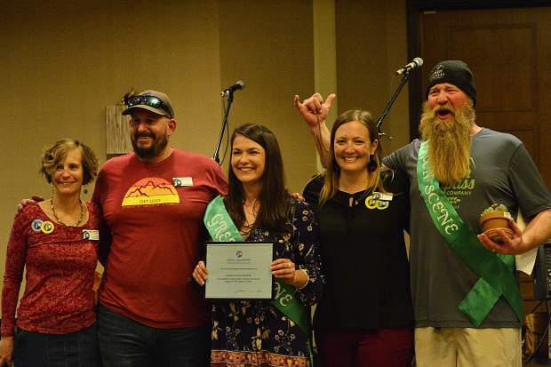 Broken Compass Brewing accepts a Green Scene award at the 28th Tim McClure Benefit on Friday, March 10, at the DoubleTree in Breckenridge.