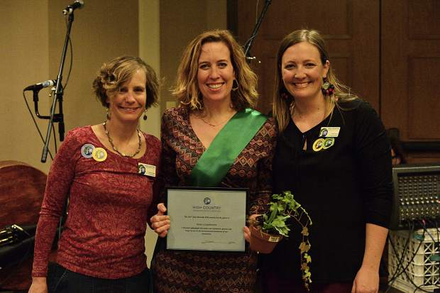 Nora Gilbertson, center, accepts a Green Scene award at the 28th Tim McClure Benefit on Friday, March 10, at the DoubleTree in Breckenridge.