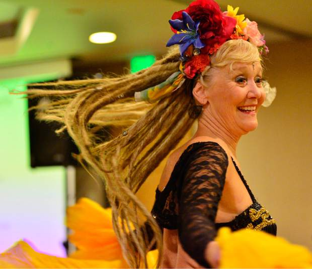 Pam Seegers of the EveryBelly Dancers performs Friday night during the 28th Tim McClure Benefit at the DoubleTree in Breckenridge.
