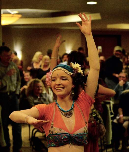 Alia Dye of the EveryBelly Dancers performs Friday night during the 28th Tim McClure Benefit at the DoubleTree in Breckenridge.