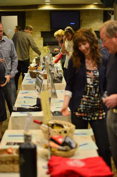 Guests peruse items set up for the silent auction Friday night at the DoubleTree in Breckenridge during the 28th Tim McClure Benefit, the High County Conservation Center's biggest fundraiser of the year.