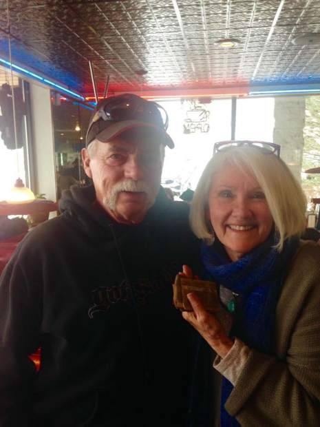 Roger Wade, left, reconnects Linda Drake with the contents of her father's long lost wallet, which Wade's son recently discovered on a hunting trip in De Beque.