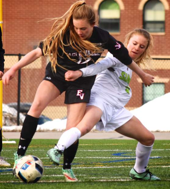 Summit junior Piper Kunst (5) fights for the ball against Eagle Valley's Kaitlyn Borah (17) during a home varsity soccer game on March 21. The Tigers lost, 1-3.
